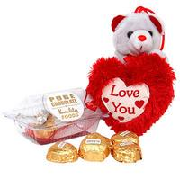 For chocolate lovers.. a teddy behind a heart & chocolates
